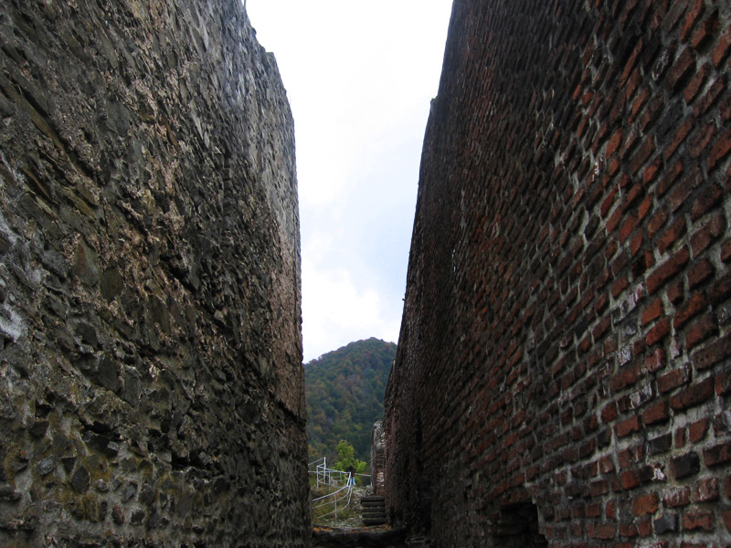 The main brick hallway leading into Castle Poenari, the real Dracula's castle, in the Transylvania region of Romania, showing the original construction and the renovation.